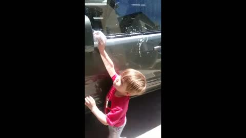 2 Year Old Levon sings Hard Knock life Washing the Car 😂