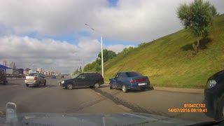 Car Rolls Onto Highway - Video