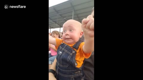 Baby Has Funny And Excited Reaction To Motor Racing
