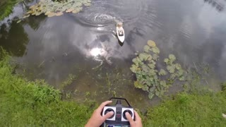 Barbie riding an RC boat catches a fish!