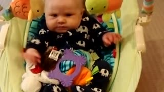 Baby adorably fails at trying to appear angry - Video