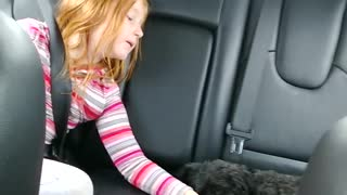 Sweet Girl Sings Her Puppy To Sleep  - Video