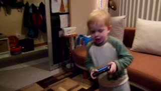 Toddler makes angry face when he dances