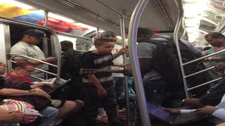 Talented Kid Sings Beautifully On A Subway Train In NYC - Video