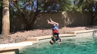 4-year-old conquers fear of diving boards, does back flip into pool