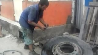 Man Inflates Tire with Fire and Pants Fall Down - Video