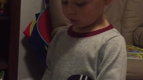 Smart And Cute Three Year Old Reading His Favorite Book
