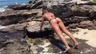 Girl Works Out on Beach - Video
