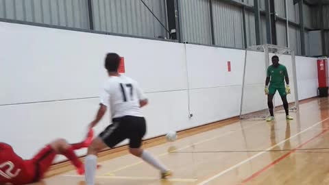 Soccer player in red hits wall
