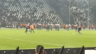 Fans clash with police during rival soccer match - Video