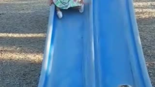 Collab copyright protection - baby girl tumbles down blue slide