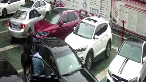 Woman Pushes Car After Accidental Reverse Gear