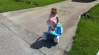 Little Girl Drives Power Wheel Car Into A Real Car - Video