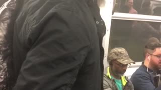 Guy singing god bless america on subway
