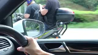 Rider and Pillion Play on Phones