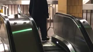 Guy keeps trying to walk down up escalator  - Video