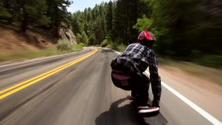 Longboarder soars down Colorado hill at 70mph! - Video