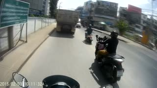Motorcyclist Narrowly Avoids Oncoming Car