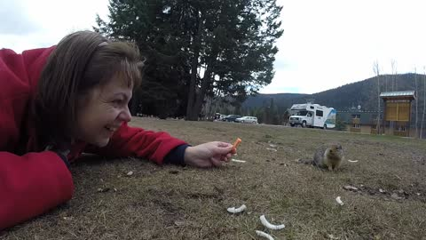Woman Tries Sneeking a Kiss From Squirrel at Manning Park
