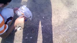 Children are doing Experiment with Bottle to make it Boat  - Video