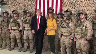 President Donald Trump and Melania Trump meet with troops