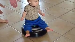 Baby riding a roomba - starring lex mubarak - Video