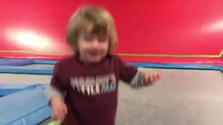 Little boy maroon trampoline fall