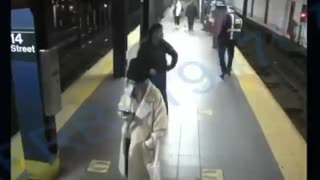 Homeless man shoves woman onto NYC subway tracks