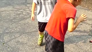 Boy Tries To Race With Shirt Attached To Gate - Video