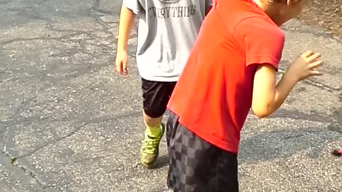 Boy Tries To Race With Shirt Attached To Gate