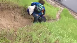Guy in blue going down hill falls down  - Video