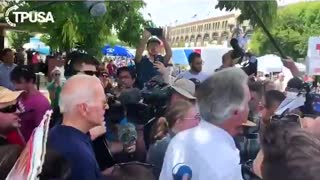 Biden grabs student's arm, answers question on gender