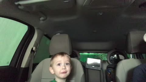 Toddler gets a front seat view of a car wash and he is AMAZED!!!
