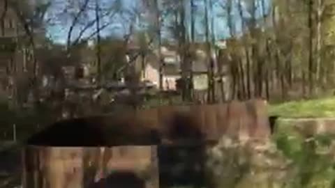 Guy in black outfit runs jumps flips