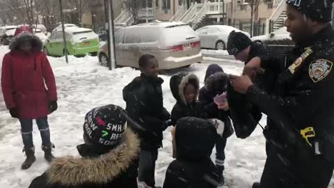 Snowball Fight Between NYPD Officers And Kids