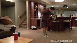 Epic trick shot using three golf clubs and a red cup - Video