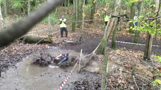 Cyclocross competitor takes break from race - Cannonballs into mud bath! - Video