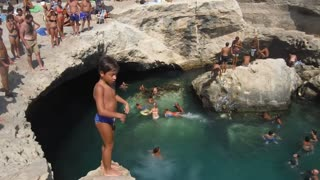 boys jumping in water amazing  - Video