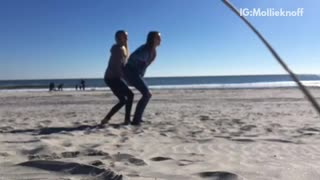 Girl trying to flip friend over faceplants