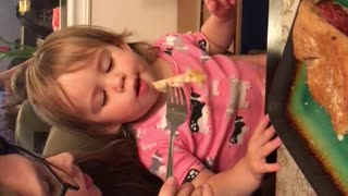 Cute toddler trying to cool her food down  - Video