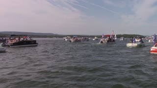 0404 Arkansas Trump Boat Parade Lake Ouachita. Drone and standing in the boat