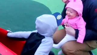 Baby girl giggles as she finds big brothers running around hilarious  - Video