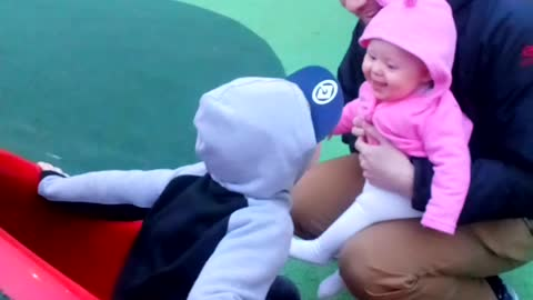 Baby girl giggles as she finds big brothers running around hilarious