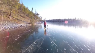 Ice Skating On A Crystal Clear Lake In Sweden - Video