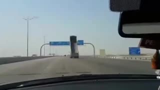 Truck Crashes And Destroys Highway Sign - Video