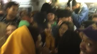 Crowded subway full of people all yell yeah
