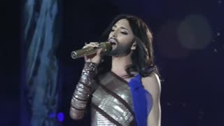 Vienna Rides Conchita Wave With AIDS Charity Ball - Video