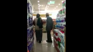 Old man expresses his love to his wife in a shop - Video