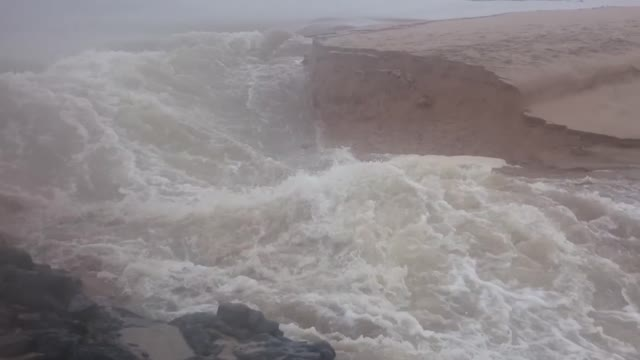 Guy Captures The Moment A River A River Cuts A New Channel To The Ocean - Video