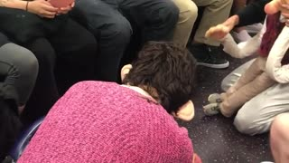 Two people on subway acting out as dolls on subway floor screaming - Video